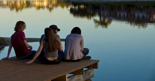warning-signs-of-depression-and-suicide-in-young-adults-teens-sitting-by-a-lake.jpg