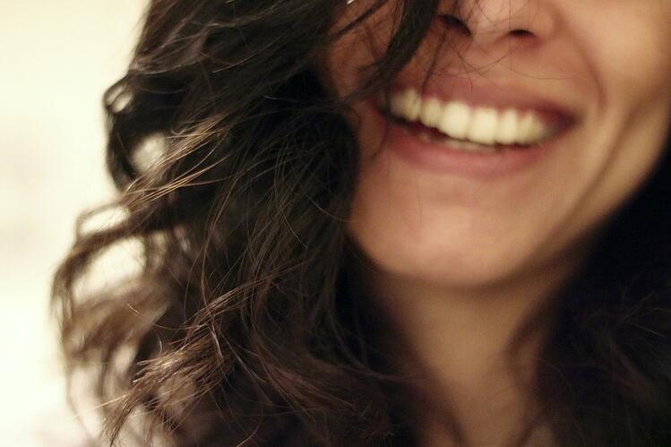 How to practice self-love for good mental health - Photo - Woman smiling.jpg