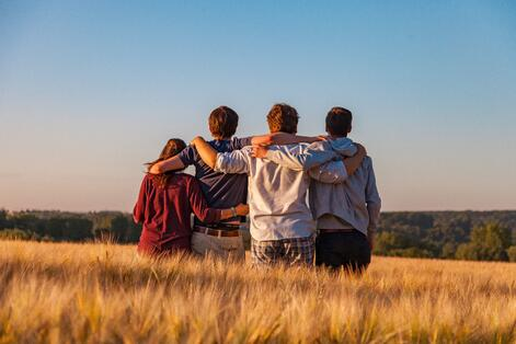 Group of teenagers linking arms
