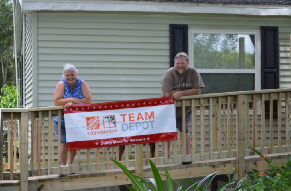 Volunteers from The Transition House build a ramp for Florida veteran